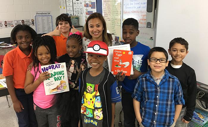 Sunday Hill reads Dr. Seuss to 3rd grade class