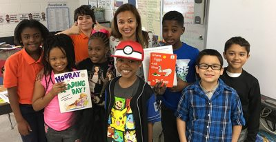 Sunday Hill reads Dr. Seuss to 3rd grade class